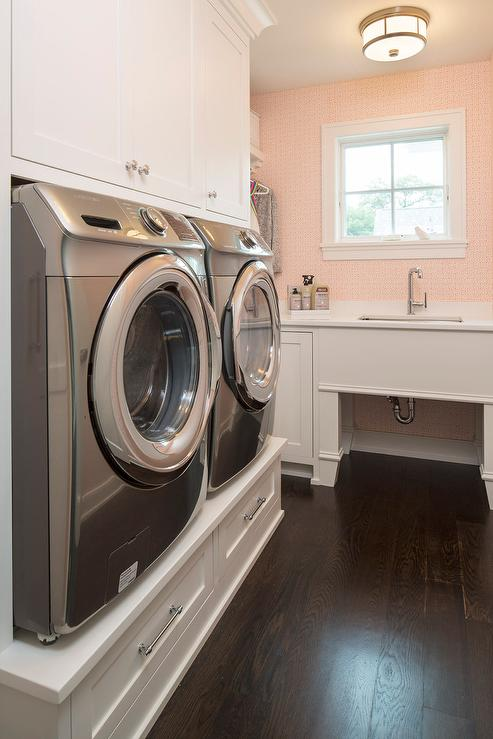 Delicieux White And Pink Laundry Room With Washer And Dryer Platform
