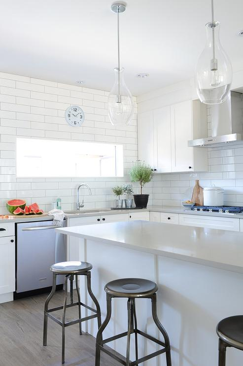 White And Gray Kitchen Features White Shaker Cabinets Adorned With Oil  Rubbed Bronze Hardware Paired With Light Gray Quartz Countertops And White  Tiled ...