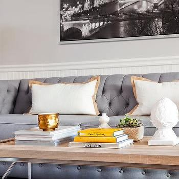 Gray Tufted Sofa With Gold Lamps