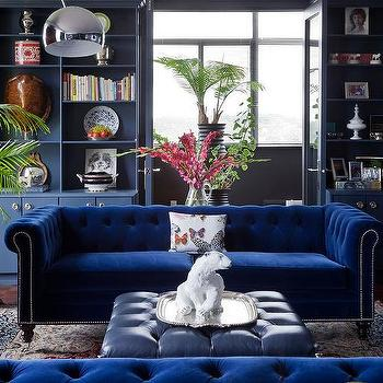 Cabin Living Room With Blue Slipcovered Sofa With Gold