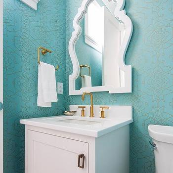 Turquoise Bathroom With Small White Sink Vanity Fitted With Gold Hardware