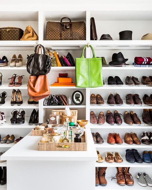 Chic Walk In Closet Boasts A Wall Of Floor To Ceiling Shelves With Acrylic  Lips Lined With Designer Bags And Shoes.