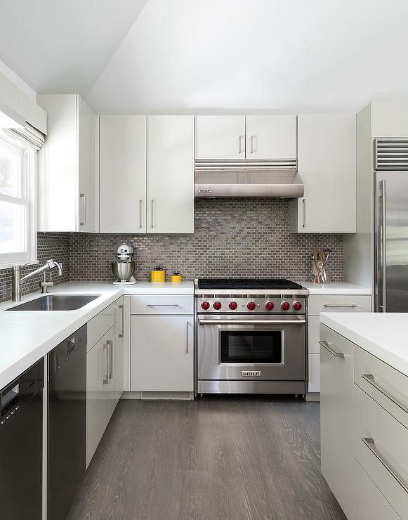 White And Gray Kitchen With Gray Mini Brick Tile Backsplash - Grey wood floor white kitchen