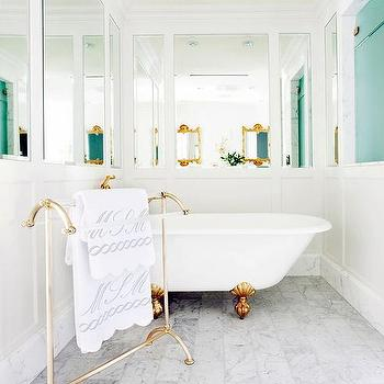 gold clam shell claw foot tub