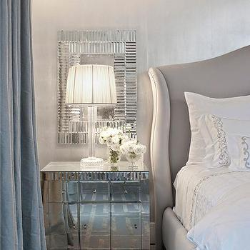 Gray Wingback Bed With Mirrored Nightstands Under Mirrors