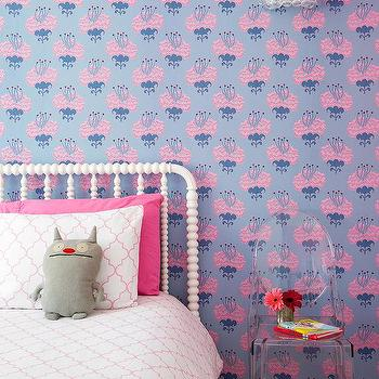 leather woven bed with pink and purple bedding
