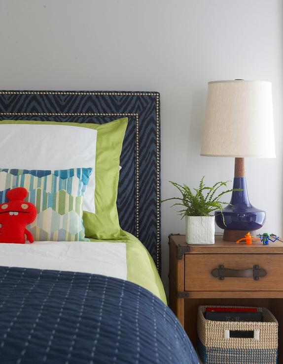 blue zebra headboard with wood nightstand fitted with leather straps