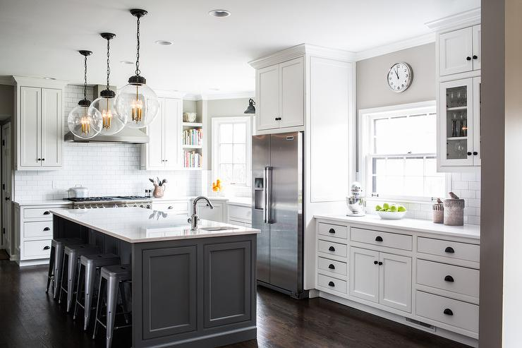 White Cabinets with Charcoal Gray Kitchen Island  Transitional
