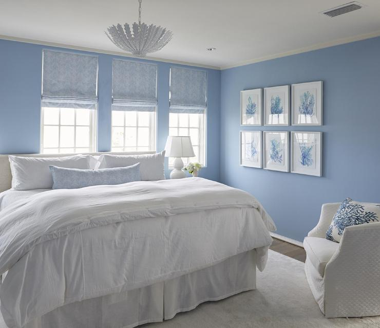 white and cornflower blue cottage bedroom with white slipcovered