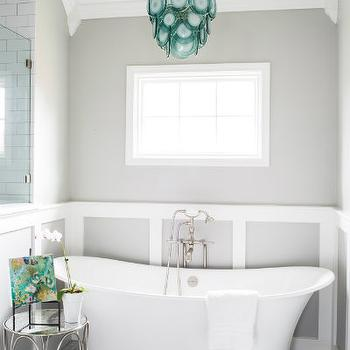Gray and blue bathroom with aqua glass chandelier over tub for Bathroom decor regina