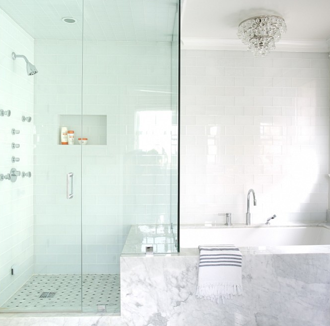 bathroom glass tile tub. Beautiful bathroom features a Robert Abbey Bling Flush Mount hangs over  marble clad tub lined with glossy white glass tiles which extends into the walk in Tub Next To Shower Design Ideas