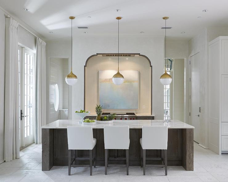 White And Gold Pendants Over Dark Stained Kitchen Island