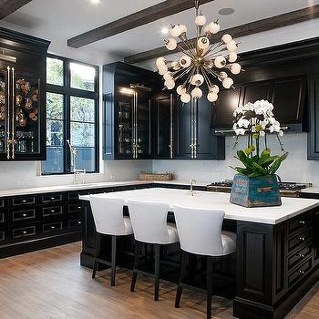 Glass front kitchen cabinets with polished brass cremone for Flat black kitchen cabinets
