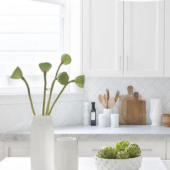 white and gray herringbone marble kitchen backsplash tiles design