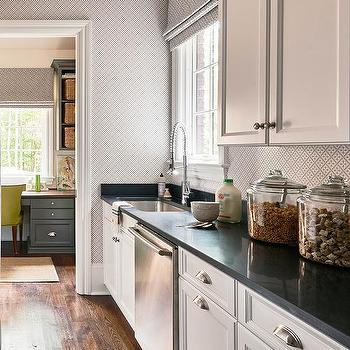 Long KItchen Pantry With White Cabinets And Black Quartz Countertops