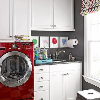 white and gray laundry room with red washer and dryer