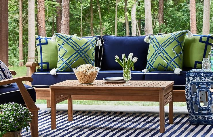 Exceptional Teak Outdoor Sofa With Blue Cushions And Green And Blue Pillows