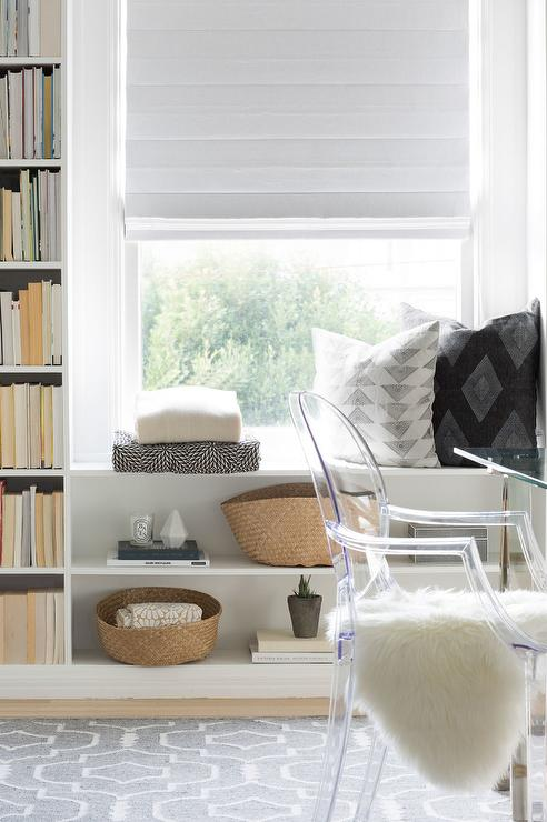 white and gray office with built in shelves around window