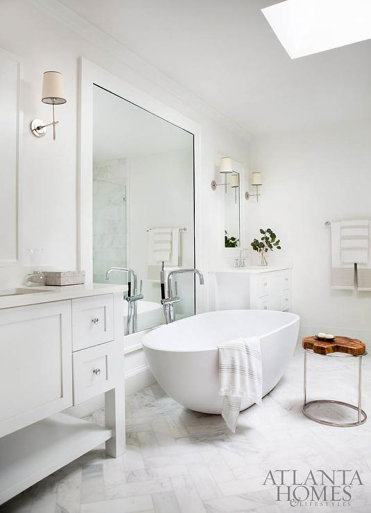 Egg Shaped Tub In Front Of White Framed Wall Mirror