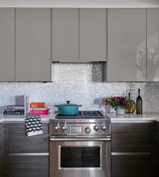 Gray Lacquered Kitchen Cabinets With White And Silver Oval Iridescent
