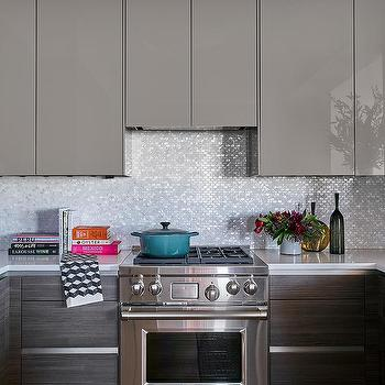 Gray Lacquered Kitchen Cabinets with White and Silver Oval Iridescent  Mosaic Tiles