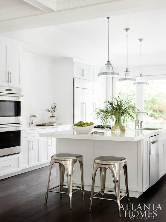 White KItchen with Dark Wood Floors and Industrial Counter Stools ...