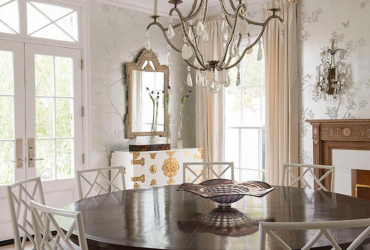 French Dining Room With Silver Metallic Wallpaper And Fireplace