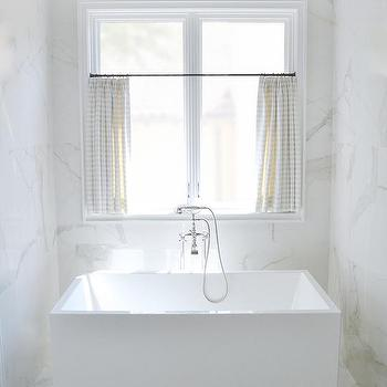 Gentil Modern Soaking Tub Placed Under Windows Dressed In Striped Curtains