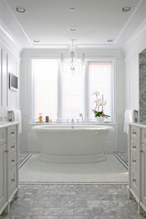 Roll Top Tub With White Herringbone Carpet Tiles Bordered With Gray Mosaic  Tiles