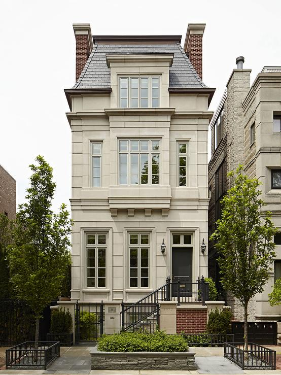 French Limestone Home with Gray Mansard Roof