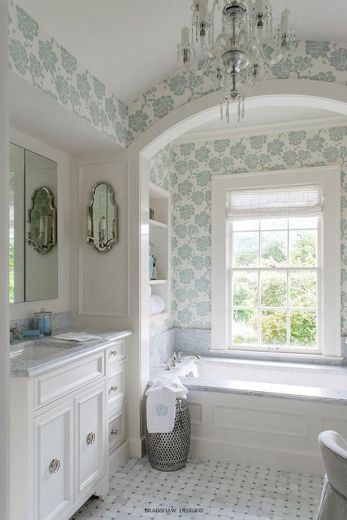 Wainscoted tub with marble deck under arched alcove for Bathroom alcove shelves