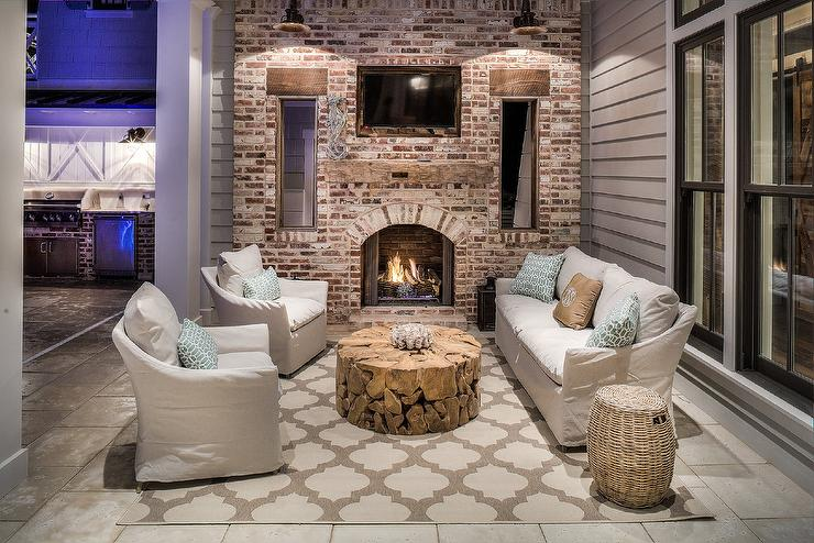 Covered Patio With Red Brick Fireplace Fitted With Flat Panel TV