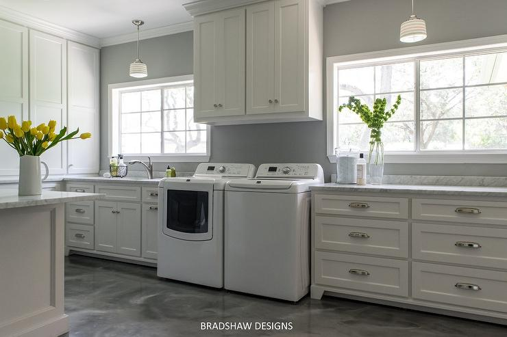 White And Gray Laundry Room With Schoolhouse Pendants