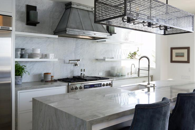 Industrial Style Kitchen With Iron Cage Pendant And Waterfall Island