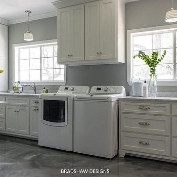 Striped schoolhouse pendant over laundry sink - Large laundry room ideas ...