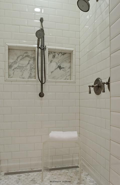 Delightful White Beveled Subway Tiles With Marble Shower Niches
