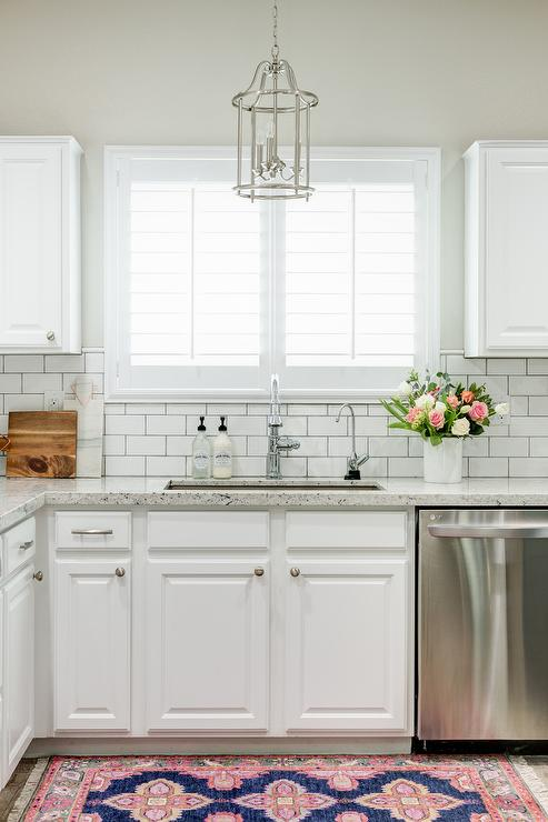 White granite kitchen countertops with white subway tile for Navy blue granite countertops