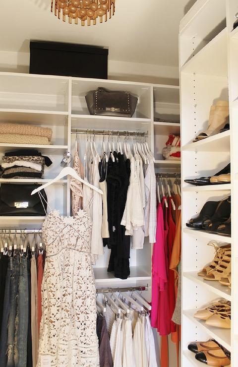 Gorgeous Walk In Closet Features A Gray Glass Chandelier Illuminating A  Modular Closet System Fitted With Purse Shelves And Shoe Shelves.