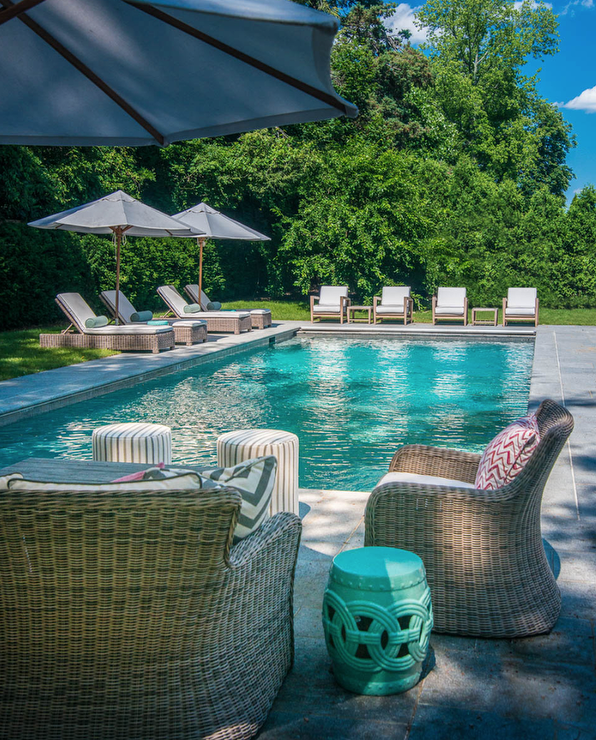 Gray wicker outdoor sofa and chairs with teal pillows for Garden pool loungers