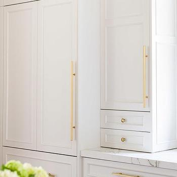 Alyssa rosenheck white and gold kitchen with two center for Long kitchen cupboard