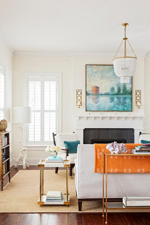 White And Blue Living Room With Orange Accents