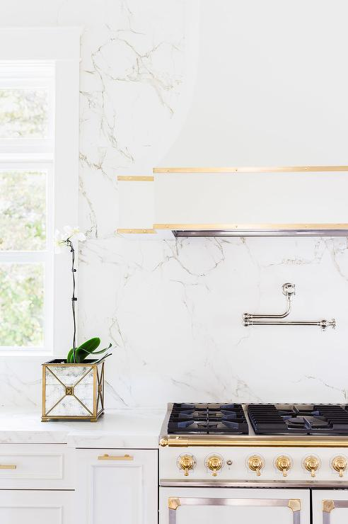Alyssa Rosenheck: White And Gold French KItchen Hood And Stove With White  Quartz Marble Like Countertops