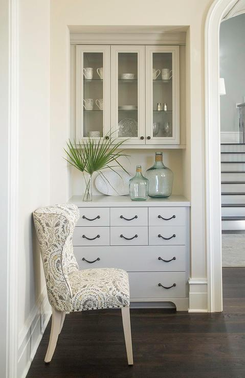 Chic Dining Room Features A Nook Filled With Glass Built In China Cabinet Over Gray Sideboard Lined Recycled Bottles