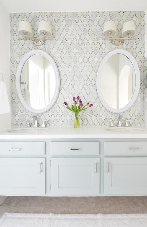 Gray Floating Washstand With White Oval Mirrors