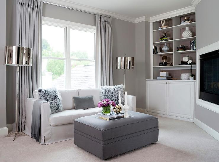 White And Gray Living Room Features A Wall Painted Lined With Slipcovered Sofa Sheepskin Pillows Cashmere Throw