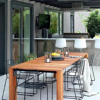 Black Outdoor Dining Table With White Outdoor Dining Chairs Design