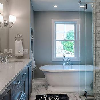 Marble clad tub with glass shelves transitional bathroom for Bathroom alcove shelves