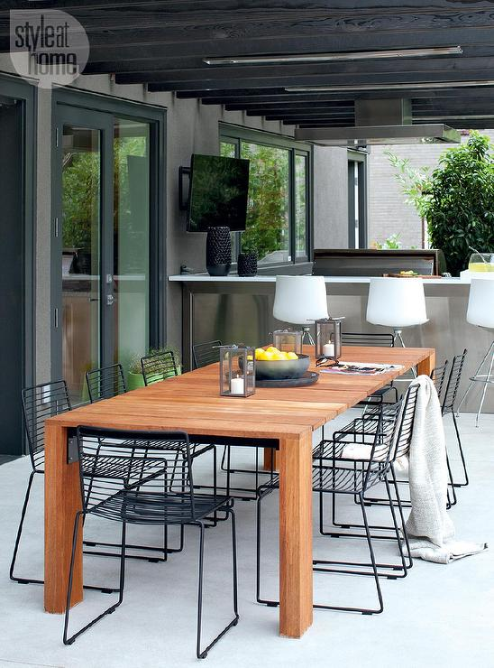 Teak Outdoor Dining Table with Black Metal Dining Chairs Under Black ...