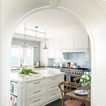 White Kitchen With Blue Subway Backsplash Tiles