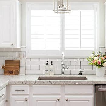 Delicieux White Granite Kitchen Countertops With White Subway Tile Backsplash
